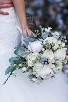 Lush and rich, the many-layered peony is so luscious, and this creamy white colour is perfect for a winter wonderland celebration in November or December (after that peonies may be hard to source).     Image via  Bridal Musings.
