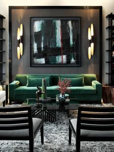 Dark walls and art work so well with this bright green sofa.  And the light fixtures are amazing too.
