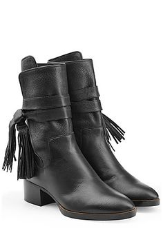 Step out in seventies style—these fringe leather boots from Chloe make a sophisticated new season statement round toe, wrap-around strap at ankle with fringe, chunky heel, textured leather upper, leather insole and outsole. #Stylebop