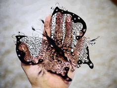 Butterfly meticulously carved out of paper