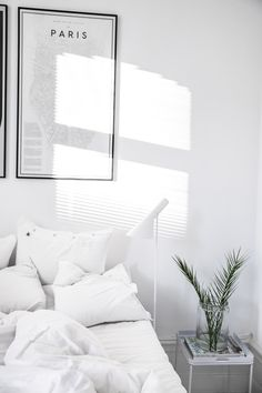 A beautiful fresh white bedroom featuring the Louis Poulsen AJ Floor Lamp. Shop…