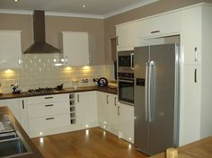 Euro Gloss Kitchen Complimenting a Large American Fridge Freezer