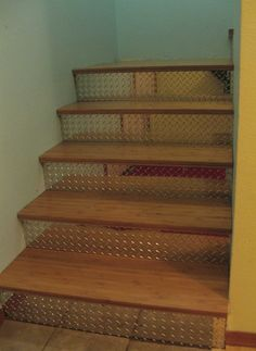 Indoor Diamond Plate Stairs - somebody's done it! I wanted to do this at the last home I lived in, and couldn't find anybody to do it. Love it.