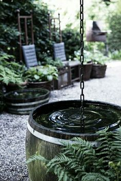 vintage wine barrel with a simple rain chain turns into a nice water feature