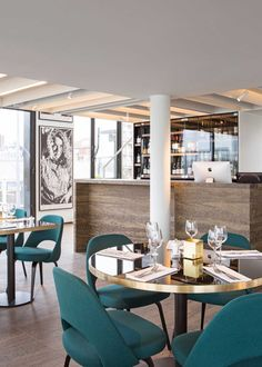 RAS waterfront restaurant is a new concept set in the iconic Zuiderterras building in Antwerp, with an elegant interior by Co.studio.