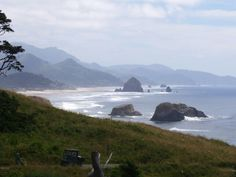 Haystack Rock and Needles at Cannon Beach, Oregon.  A Travel Guide to Murder