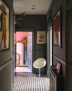 A moody corridor in Farrow Ball color curator Joa Studholme's home is painted in the company's Down Pipe and culminates in a bedroom painted their Nancy's Blushes pink. Hallway Colours, House Design, Farrow Ball, House, Hallway Paint Colors, Home, Hallway Designs, Hallway Colour Schemes, Hallway Paint