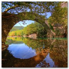 Ancient stone bridge over the Voidomatis River, Greece. (Photo by Giorgos Vintzileos) Beautiful World, Beautiful Places, Beautiful Gorgeous, Peaceful Places, Beautiful Scenery, Absolutely Gorgeous, Old Bridges, Burn Bridges, Building Bridges
