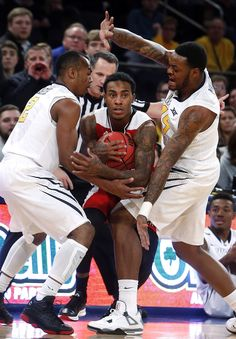 WVU BASKETBALL: Huggins fires up Mountaineers in Gotham Classic win