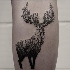 Amazing tattoo - a stag silhouette made up of tree branches