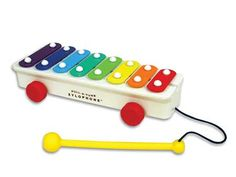 Retro Fisher Price Pull-A-Tune  $29.99  Introduced in 1957, Pull-A-Tune Xylophone has made music and delighted children all over the world. With eight rainbow colored bars and a mallot, today's Pull-A-Tune Xylophone makes beautiful melodies for a whole new generation of children to enjoy!
