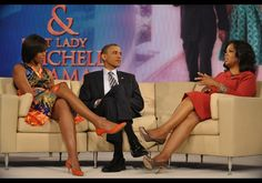 US President Barack Obama and First Lady Michelle Obama chat with talk show host Oprah Winfrey during a taping of the Oprah Winfrey show April 27, 2011 at Harpo Studios in Chicago.