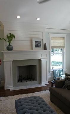 Many mantles in new homes that we've seen don't extend to the ceiling.  Could totally add to the mantle yourself and extend it to the ceiling with boards and molding.  Really like this look.