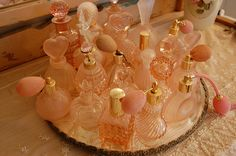 Pink perfume atomizers and pink perfume bottles. Some of them depression glass and some are from the 40s and 50s.