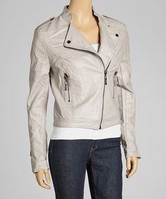 An off-center front zipper combines with a soft and sleek finish to artfully craft an edgy, chic piece that's perfect for the woman seeking stand-out style. Measurements (size S): 21'' long from high point of shoulder to hemShell: 55% polyurethane / 45% viscoseLining: 100% polyesterDry cleanImported