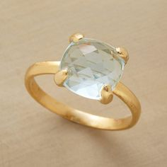 BLUE WATERS RING--The infinite hues and facets of this blue waters topaz ring offer sparkling possibilities. 18kt goldplated band and prong-set. Whole sizes 6 to 8.