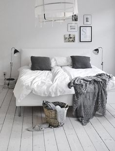 Love the grey and the frames above the headboard...