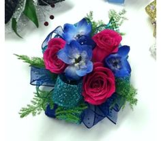 Bright blue and hot pink wrist corsage for prom
