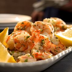 Marinating precooked shrimp in garlic- and lemon-infused oil creates a simple yet elegant appetizer. Recipe: Lemon-Garlic Marinated Shrimp   - Delish.com