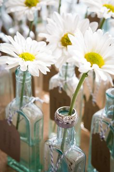 little antique bottles with flowers escort cards
