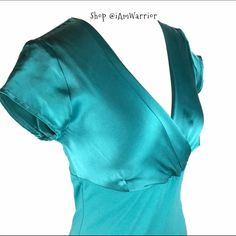 Turquoise satin and cotton empire waist top Gorgeous serene turquoise color top has satin bust and sleeves and knit bodice and back. Flattering v-neck. Good condition. Nine West Tops