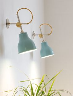 Turquoise MK3 Wall Lights add a pop of colour in a minimal interior | Artifact Lighting Ltd