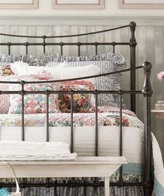 Classic, beautiful metal bedroom and sweetly lovely linens.