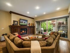 Traditional Living Room with metal fireplace, Carpet, Pella Architect Series Sliding Door with Traditional Grille Pattern