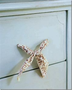 16 DIY Ideas I really like the fabric drawer pulls! Inexpensive, creative, and you can frequently change out the fabric to keep things interesting!