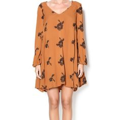 FIRM** Free People Emma's Embroidered Swing Dress Really pretty boho style!! Gauzy fabric, a really pretty burnt orange/pumpkin color (is called tobacco online) has pockets, and gorgeous embroidery throughout. Is 100% AUTHENTIC Free People bought from Nordstrom. Runs big, if you are an extra large this should work for you! If you have any questions please feel free to ask! Sorry I don't model clothing! 32 1/2 length, 100% Rayon, lined. Only worn once for a few hours. Medium =12 (but again…