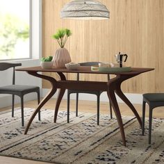 """null This dining table is great for hosting a dinner party (or eating dumplings alone in your sweatpants). Whatever the occasion, this engineered wood table is a sure win, and thanks to its different finishes, it'll work in most styles and color schemes. Featuring a rectangular 59"""" long tabletop, this table will seat up to four comfortably. Four curvy boomerang-like legs support the design with a wide crossbar. To assemble, simply attach the base. Color: Natural Walnut"""