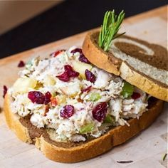 Healthy chicken salad made with Greek yogurt, dried cranberries, fresh apples and rosemary.
