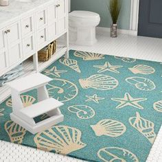 Great Deals on Monticello Cardita Shells Hand-Woven Turquoise Indoor/Outdoor Area Rug By Beachcrest Home Large Area Rugs, Blue Area Rugs, Ocean Rug, Coastal Area Rugs, Stenciled Floor, Floor Stencil, Turquoise Rug, Indoor Outdoor Area Rugs, Coastal Style
