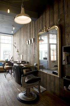 This space cleverly combines masculine and feminine design. I love the gilded mirror against the wooden panels. I would use similar mirrors to draw up daily specials or menus in a cafe setting. #Truffle. Hairdresser and make up boutique.