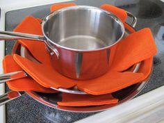 Homemade Pan Protectors - http://blog.diynetwork.com/maderemade/how-to/make-your-own-no-sew-pan-protectors/