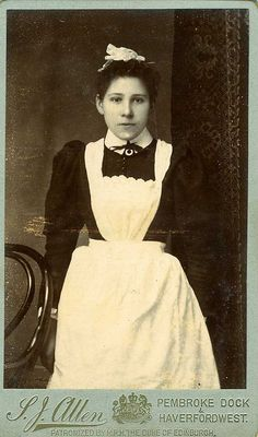 A good picture of a maid. Love the detail on the cap