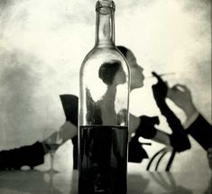 This is one of my favorite compositions by photographer Alexey Brodovitch. The mood is set by the use of grayscales (it is elegant, timeless) and the eye jumps around between the lighter hues and the darker ones. The illusion created by the bottle's perfect placement gives the image depth. This image could sell anything... wine, cigarrettes, dresses... It sells a lifestyle.