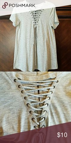 Gray short sleeve shirt Gray short sleeve, t shirt material, shirt with laces. Casual...wider at the bottom for a loose fit. No tags but never worn. loveriche Tops Tees - Short Sleeve
