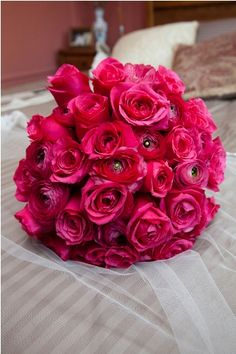 Hot pink bouquet of roses and ranunculus, modern and romantic!