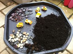 "Construction in the tuff spot outdoors at Childminding Watford Playful Minds ("",)"