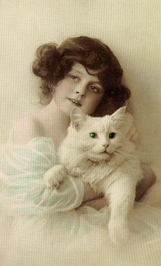 Girl with her white cat.