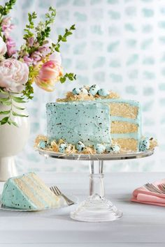 SPECKLED MALTED COCONUT CAKE: A cake speckled like a fresh robin's egg is about as Easter as it gets. Tuck soft blue eggs on mini Phyllo nests for the ultimate cake topper. Click through for more Easter dessert ideas.