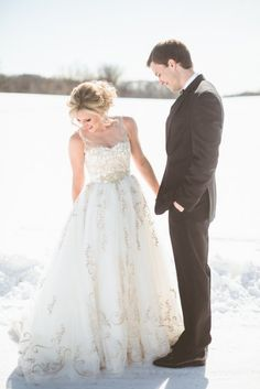 the snow make the perfect backdrop for this precious couple | Photography by Paper Antler | www.stylemepretty.com | #winterwedding #brideandgroom #snow