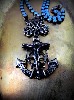 A GREAT CALM - a nautical style ave maria crucifixion necklace.