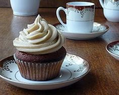 Frost these warmly spiced cupcakes with toffee for an irresistibly grown up party treat from Celia Plenders