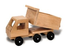 "Dump Truck - This giant dump truck is a classic favorite. Large, working dumpster with swinging gate provides for long hours of imaginative play. Part of the TAG Tuff Trucks series which features solid, 3/4"" thick oak construction, large size, moving parts, turning cabs and non-marking wheels. $89.95"