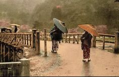 Women on a bridge with parasols. Old Japan
