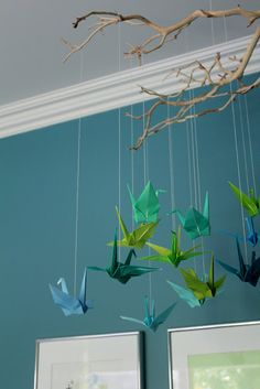 origami mobile  hung with kite string on a  manzanita branch
