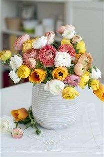 Soft and bright yellow ranunculus arrangement