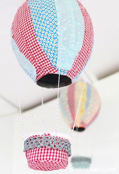 papermache-hotairballoon. the hot air part is paper mache, then covered with fabric. so cute!